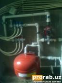 Здесь изображена система отопления теплого пола. Которая подсоединена к котлу старого типа...