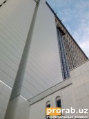 Облицовка фасада алюкобондом здания «Шарк» на сквере